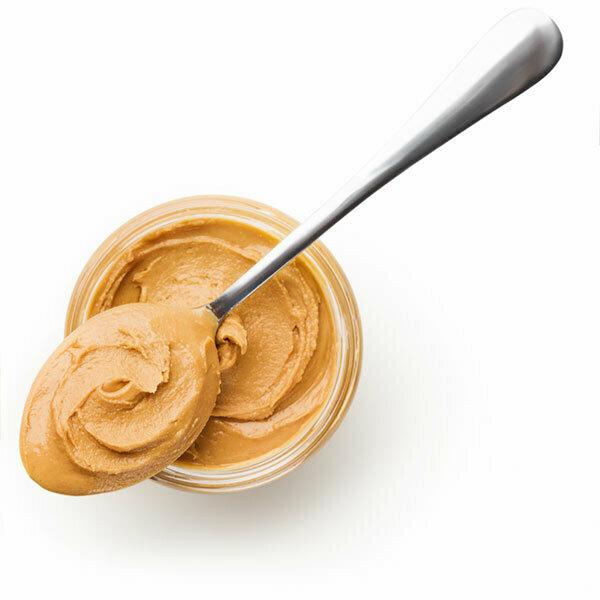 open peanut butter jar with spoon