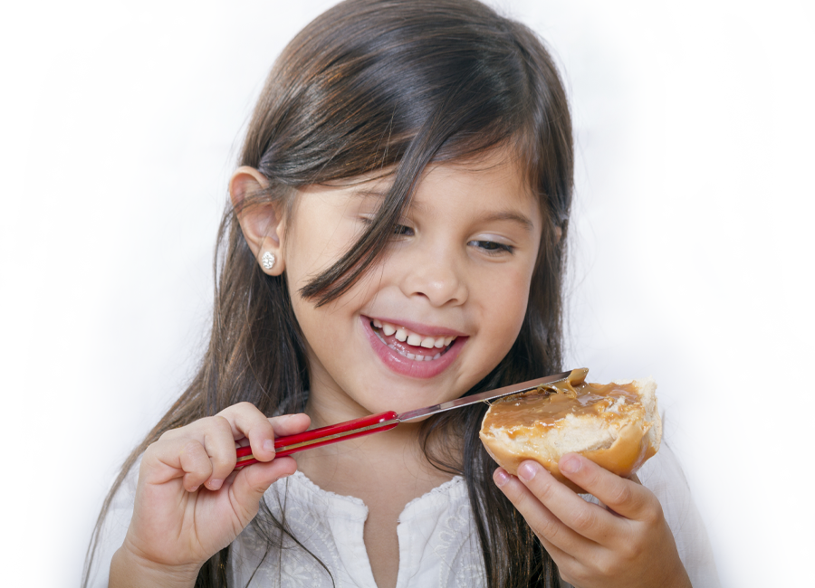young girl eating peanut butter